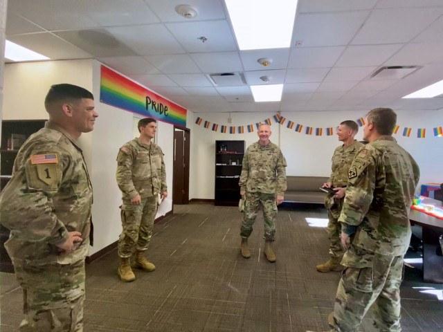(Center) Maj. Gen. Dennis LeMaster, MEDCoE Commanding General and Cmd. Sgt. Maj. Clark Charpentier, MEDCoE Command Sergeant Major speak with Brigade Leaders and Diversity, Equity and Inclusion (DEI) Center staff after the ribbon cutting ceremony marking the center's grand opening on June 2, 2021 on Joint Base San Antonio-Fort Sam Houston.