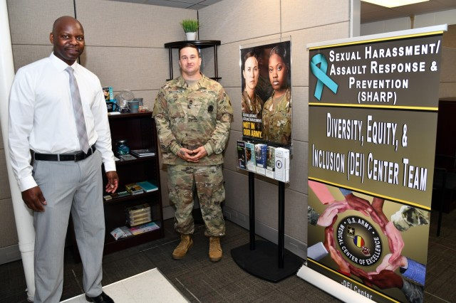 (Left) Mr. Curtis Warren, MEDCoE Sexual Harassment/Assault Response and Prevention (SHARP) Program Manager pictured with Sgt. 1st Class Michael Drapala, SHARP Victim Advocate in the SHARP office after the U.S. Army Medical Center of Excellence (MEDCoE) Diversity, Equity and Inclusion (DEI) Center Ribbon Cutting Ceremony on June 2, 2021.