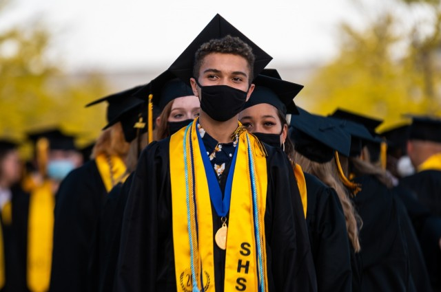 Stuttgart High School student council president, Kenneth Roedl, lines up in front of his fellow graduates during an outdoor, drive-in graduation ceremony at Panzer Barracks, Germany, June 2, 2021.