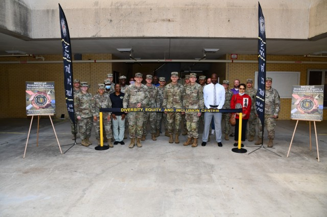 A ribbon-cutting ceremony marked the official opening of the U.S. Army Medical Center of Excellence (MEDCoE) Diversity, Equity and Inclusion (DEI) Center on June 2, 2021 on Joint Base San Antonio-Fort Sam Houston.  The ceremony was hosted by Maj. Gen. Dennis LeMaster, MEDCoE Commanding General and Cmd. Sgt. Maj. Clark Charpentier, MEDCoE Command Sergeant Major (pictured center) and was attended by over two dozen Soldiers, Civilians and leaders.