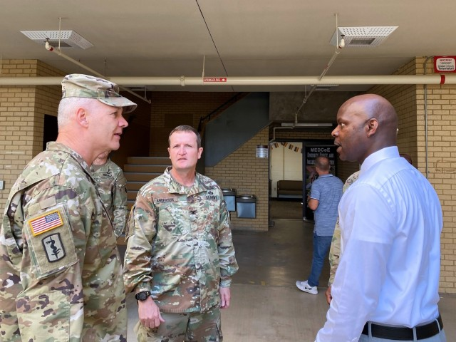 (Left) Maj. Gen. Dennis LeMaster, US Army Medical Center of Excellence (MEDCoE) Commanding General speaks with Col. Wesley Anderson, 32d Medical Brigade Commander (center) and Mr. Curtis Warren, MEDCoE Sexual Harassment/Assault Response and Prevention (SHARP) Program Manager after the MEDCoE Diversity, Equity and Inclusion (DEI) Center ribbon cutting ceremony that marked the center's grand opening on June 2, 2021, Joint Base San Antonio-Fort Sam Houston.