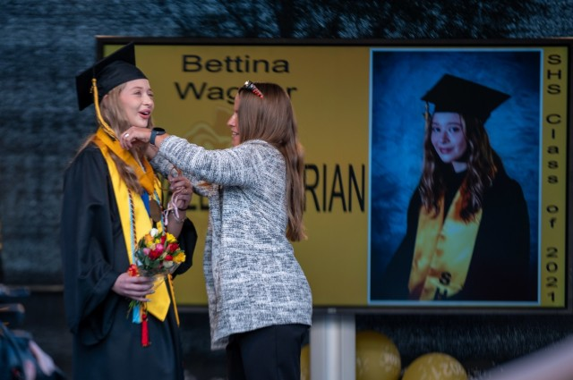 Stuttgart High School co-valedictorian, Bettina Wagner receives her valedictorian medal during an outdoor, drive-in graduation ceremony at Panzer Barracks, Germany, June 2, 2021.