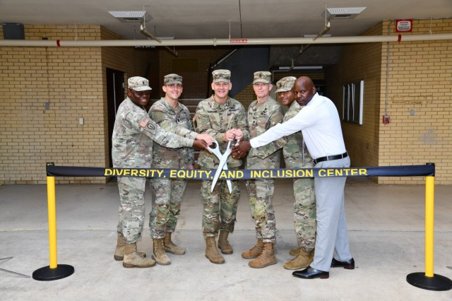 A ribbon-cutting ceremony marked the official opening of the U.S. Army Medical Center of Excellence (MEDCoE) Diversity, Equity and Inclusion (DEI) Center on June 2, 2021, Joint Base San Antonio-Fort Sam Houston.  Pictured (left to right) Chaplain (Maj.) Oyedeji Idowu, 32d Medical Brigade Chaplain and acting Command Chaplain; Capt. Chad Beach, Director, DEI Center; Maj. Gen. Dennis LeMaster, MEDCoE Commanding General; Cmd. Sgt. Maj. Clark Charpentier, MEDCoE Command Sergeant Major; Master Sgt. Jachen Smith, MEDCoE Equal Opportunity Advisor; and Mr. Curtis Warren, MEDCoE Sexual Harassment/Assault Response and Prevention (SHARP) Program Manager.