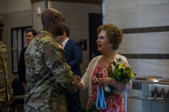 Fort Jackson Commander Brig. Gen. Milford H. 'Beags' Beagle Jr. greets Jo Lynn Allen after the dedication ceremony for the Maj. Gen. James B. Allen Jr. Hall May 27.
