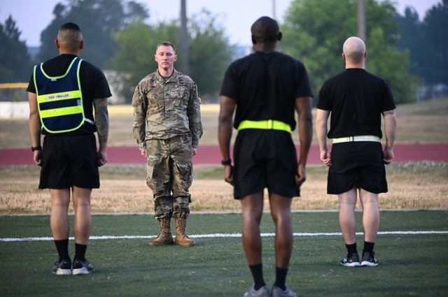 Staff Sgt. Cabot Cobb, an Army School of Music drill instructor and the Combined Arms Support Command Drill Sergeant of the Year, leads a group of Soldiers during the BWC Warrior Task and Battle Drills event that took place on May 26 at Fort Lee's Williams Stadium. Cobb received the Army Commendation Medal for his achievement. (U.S. Army photo by 1st Lt. Tom Burcham)
