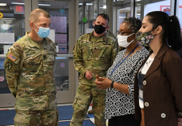 Sgt. Maj. of the Army Michael Grinston talks with Robin Banks, Child and Youth Services chief, and Laura Manganaro, Chapel Drive Child Development Center facility director, during his visit to Fort Drum on June 3. (Photo by Mike Strasser, Fort Drum Garrison Public Affairs)