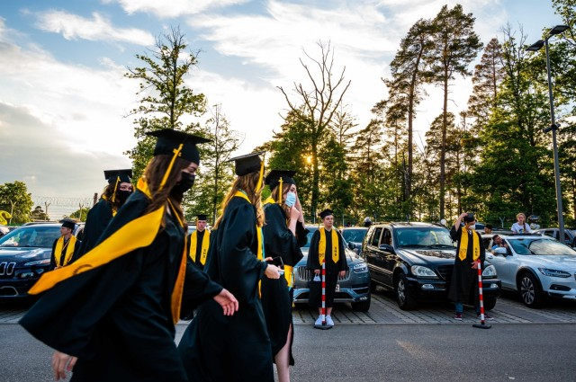 Stuttgart High School graduates approach the graduation stage during an outdoor, drive-in graduation ceremony at Panzer Barracks, Germany, June 2, 2021.