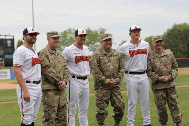 Soldiers assigned to the 85th U.S. Army Reserve Support Command headquarters pause for a photo with players from the Schaumburg Boomers baseball team, May 31, 2021, in Schaumburg, Illinois during a Memorial Day home game against the Gateway Grizzlies. The Soldiers participated in pre-game activities throwing out the ceremonial first pitch and conducted a presentation of colors during the playing of the National Anthem.  (U.S. Army Reserve Photo by Anthony L. Taylor)