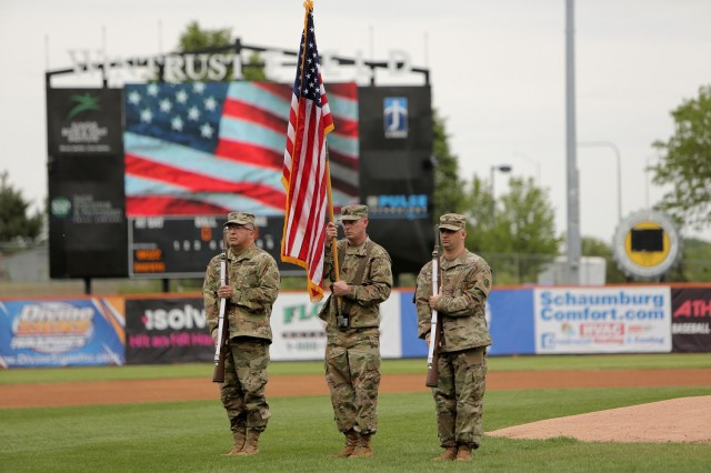 The 85th U.S. Army Reserve Support Command color guard team presents the Nation's Colors during the Schaumburg Boomers' Memorial Day home game, May 31, 2021, against the Gateway Grizzlies. Soldiers from the 85th USARSC additionally participated in pre-game activities throwing out the ceremonial first pitch.  (U.S. Army Reserve Photo by Anthony L. Taylor)