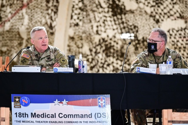 Gen. Paul J. LaCamera (left), U.S. Army Pacific commanding general, speaks at the Joint Health Service Support Rehearsal of Concept Drill hosted by Maj. Gen. Michael L. Place (right), 18th Medical Command (DS) commanding general. The ROC Drill, held on Wheeler Army Airfield – Hawaii, March 24, helped synchronize joint military support efforts for all medical assets and logistics within the Indo-Pacific theater while ensuring effective command and control.