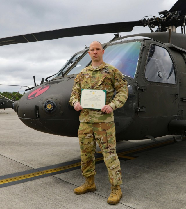 CW2 Brasher with his citation.
