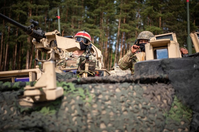 1st Lt. Matthew Homsy, Abrams tank commander, 2nd Battalion, 8th Cavalry Regiment, 1st Armored Brigade Combat performs a radio communications check before maneuvering his tank platoon to its battle position during exercise Iron Wolf in Rukla, Lithuania, May 25. 2nd Batt. 8th Cav. Reg rapidly integrated a company-plus size element, within the Lithuanian Armed Forces, before serving as the opposing force, led by the Enhanced Forward Presence Battle Group. 2nd Batt. 8th Cav. Reg. troopers and the EFP Battle Group, Lithuania worked together throughout the 12-day exercise which included mounted and dismounted tactical training. (Photo courtesy of 1st Lt. Yair Da Costa, eFP Public Affairs Officer)