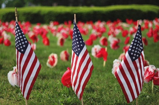 Flags traditionally are used to decorate grave sites during Memorial Day.
