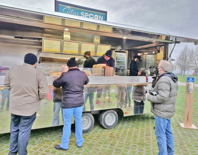 Photo by Karl Weisel William Montgomery (center) helps serve patrons at the Silver Spoon's Burger Bliss on Clay Kaserne Jan. 7, 2021.