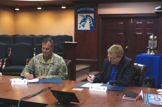 Lt. Gen. Michael E. Kurilla, commanding general of XVIII Airborne Corps (left) and Dr. Patrick Baker, DEVCOM ARL director sign a memorandum of understanding at Fort Bragg, North Carolina. As part of the agreement, DEVCOM ARL will team top academic institutions with Soldiers in the 82nd and 101st Airborne Divisions to rapidly solve problems and accelerate the transition of the solutions into the Army.