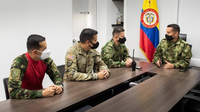 U.S. Army Chief Warrant Officer 3 Mauricio Garcia, meets with Lt. Col Milton Monroy, the Aviation Training Battalion commander, and staff at the Tolemaida Army Base, Colombia. Garcia, a UH-60M Black Hawk pilot and aviation safety officer, is deployed here as part of a technical advising team from Army Security Assistance Command's Fort Bragg-based training unit, the Security Assistance Training Management Organization. (photo by Richard Bumgardner)