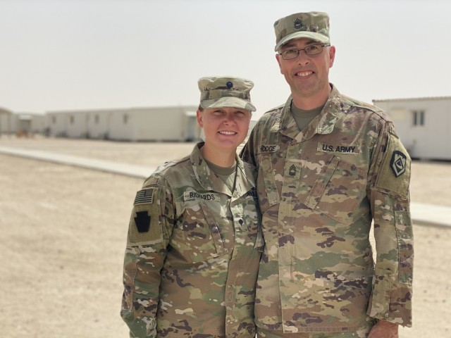 Spc. Emilee Richards (left), a unit supply specialist in the 2nd General Support Battalion, 104th Aviation Regiment, West Virginia Army National Guard and Master Sgt. Kendall Hodge (right), a Logistics noncommissioned officer in the 111th Engineer Brigade, recently crossed paths while deployed in Kuwait. This duo also happens to be father and daughter.