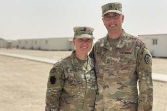 Father and daughter reunite in Kuwait during deployment