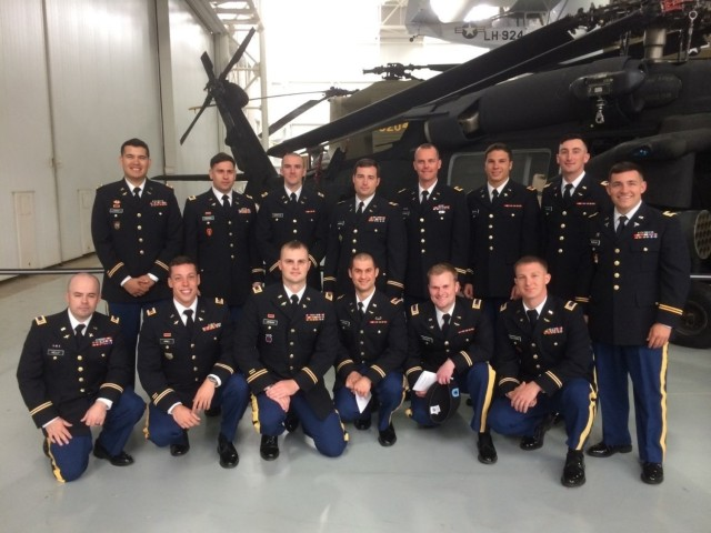 U.S. Army Chief Warrant Officer Mauricio Garcia, a freshly minted UH-60M Black Hawk pilot, poses with his classmates after graduation from the UH-60M qualification course at Fort Rucker, Alabama. (Courtesy photo)