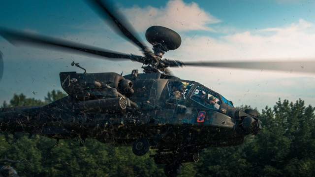 Hungarian Defense Force Brig. Gen. József Koller, the 86th Helicopter Base Garrison Commander, takes off for a leader orientation flight with U.S. Army Chief Warrant Officer 3 Joseph Lorman of the 12th Combat Aviation Brigade on June 3, 2021, during exercise Saber Guardian 21, part of the DEFENDER-Europe 21 series of exercises. Cross-training flights like these help to give allies a shared understanding of each other's capabilities and enables interoperability and communication.