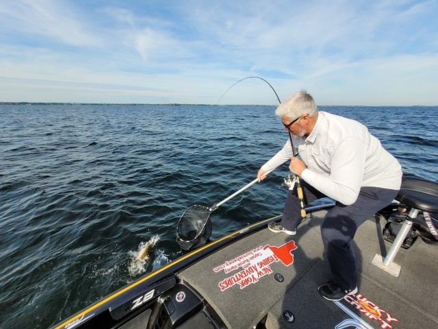 Burnie Haney, a local charter captain and 10th Mountain Division (LI) retiree, has a lifelong passion for angling, and he can often be found fishing from his boat in Lake Oneida. (Photo by Mike Strasser, Fort Drum Garrison Public Affairs)