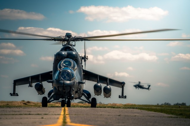 A Hungarian Defense Force Mi-24 Hind spins up for a leader orientation flight with AH-64 pilots from the 12th Combat Aviation Brigade at Szolnok Air Base, Hungary on June 3, 2021, during exercise Saber Guardian 21, part of the DEFENDER-Europe 21 series of exercises.