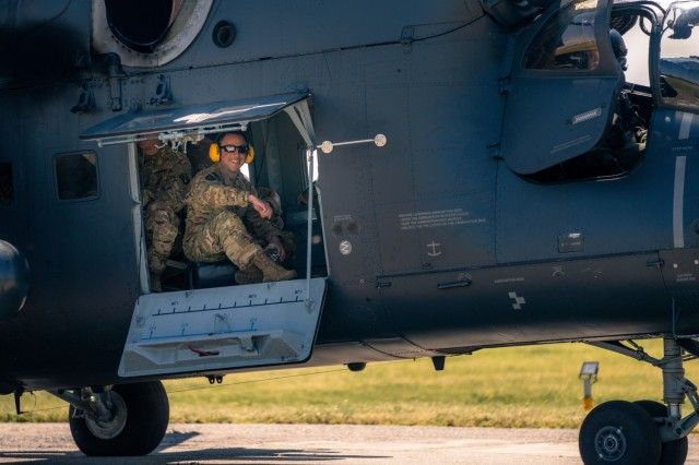 U.S. Army attack helicopter pilots of the 12th Combat Aviation Brigade, spin up for an orientation flight in a Mi-24 Hind helicopter with Hungarian Defense Force Col. Zoltán Rolukó at Szolnok Air Base, Hungary on June 3, 2021, during exercise Saber Guardian 21, part of the DEFENDER-Europe 21 series of exercises. Cross-training flights like these help to give allies a shared understanding of each other's capabilities and enables interoperability and communication.