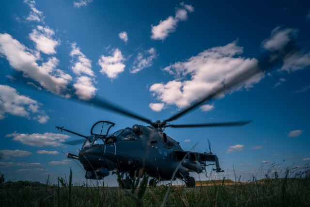 U.S. Army Lt. Col. Matthew Cole, commander of 1st Battalion, 3rd Aviation Regiment, 12th Combat Aviation Brigade, spins up for a leader orientation flight in a Mi-24 Hind helicopter with Hungarian Defense Force Col. Zoltán Rolukó at Szolnok Air Base, Hungary on June 3, 2021, during exercise Saber Guardian 21, part of the DEFENDER-Europe 21 series of exercises.