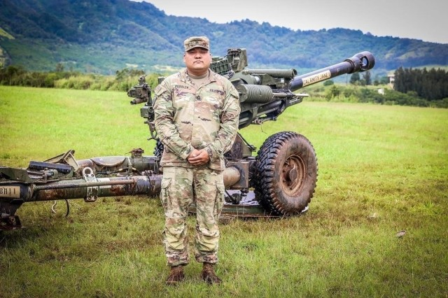 Schofield Barracks, HI — Sgt. 1st Class Mark Peralta a 13J, Senior Fire Control Non-Commissioned Officer, assigned to 25th Infantry Division Artillery, 25th Infantry Division during M119 Howitzer live fire range at Schofield Barracks, Hawaii. (U.S. Army photo by Spc. Jessica B. Scott)