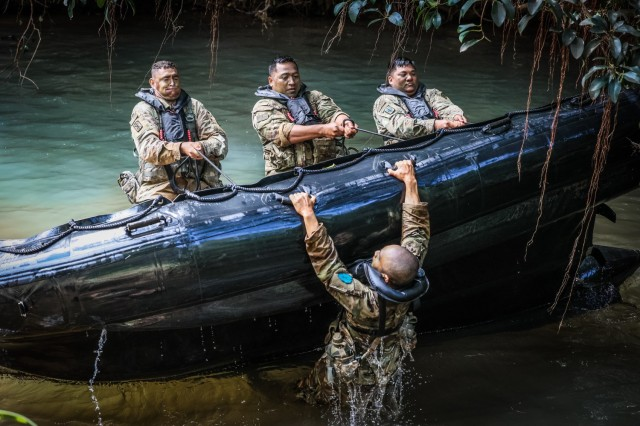 """Schofield Barracks, HI —Sgt. 1st Class Mark Peralta a 13J, Senior Fire Control Non-Commissioned Officer assigned to 25th Infantry Division Artillery, 25th Infantry Division capsizes Zodiac boat while executing waterborne operations during the 25th DIVARTY 3-day exercise called """"Thunder Stripes"""" consisting of rigorous, competitive tactical events for Senior Non-Commissioned Officers on April 8, 2021, at Schofield Barracks East Range, Hawaii. This NCO LPD """"Thunder Stripes"""" event was designed to build cohesive teams by elevating these key leaders' physical and mental toughness, camaraderie, and commitment to the organization and Army values. Uniting the soldiers through shared hardship, this voluntary challenge built character, trust, and resilience, honoring the sexual assault victims within our formation and reinforcing each leader's responsibility to protect our people and mission by eliminating and preventing sexual assault. (U.S. Army photo by Spc. Jessica B. Scott)"""