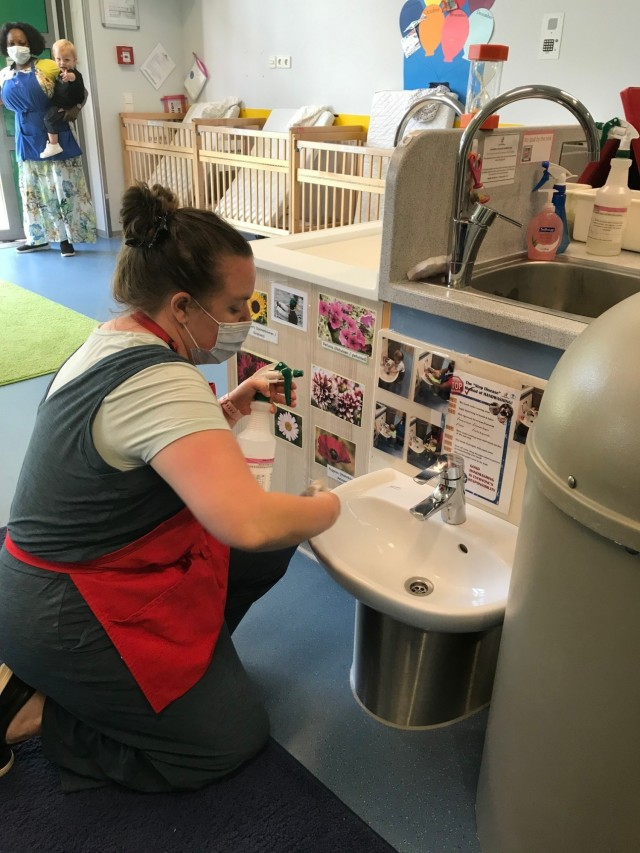 Joan Engel cleans the sink in the infant room at the end of the day.  All surfaces in the room are cleaned with soap and water and then sprayed with a sanitizing solution.