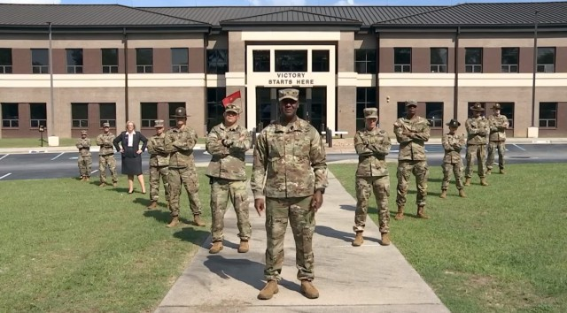 """U.S. Army Training Center and Fort Jackson commander Brig. Gen. Milford H. 'Beags' Beagle Jr. poses with his """"Squad"""" of post headquarters support staff during a """"This Is My Squad"""" video shoot."""