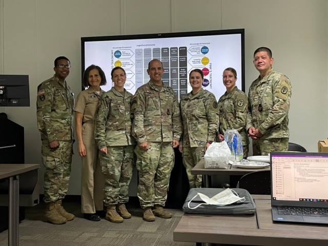 From Left to right: Col. Enrique Smith-Forbes, Cmdr Maria Barefield, Maj, Jamie Bell, Col. Theodore Croy, Capt. Lyddia Petrofsky, Capt. Corinne Heffernan, and Lt. Col. Brian Gregg.