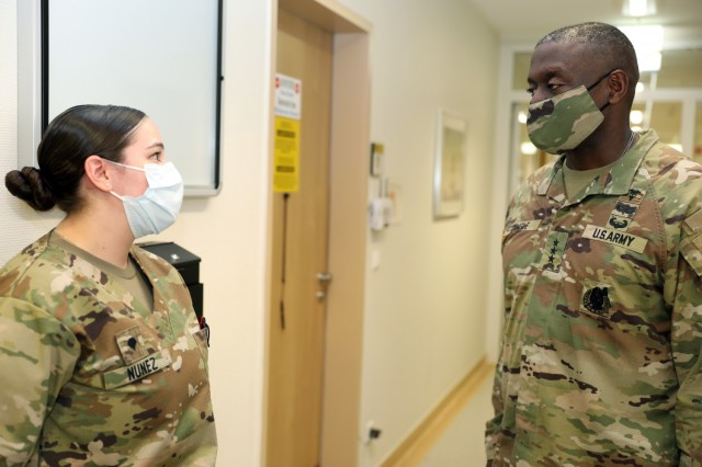 Spc. Alyssa Nunez, a pharmacy technician at the Baumholder Army Health Clinic, provides an overview of her job to Lt. Gen. R. Scott Dingle, the 45th Surgeon General of the United States Army and Commanding General, United States Army Medical Command.