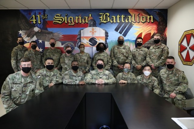 Lt. Col. Tilisha Lockley with her team in Korea after a R2 Team Building Event. The 5-foot-4-inch-tall lieutenant colonel commands the 41st Strategic Signal Battalion in the Republic of Korea (ROK). The 41st Strategic Signal Battalion is the largest operational signal battalion in the U.S. Army.
