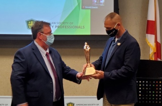 Shawn Ankerich, a health and safety specialist, receives a Safety Professional of the Year Award during a ceremony hosted by the American Society of Safety Professionals Alabama Chapter.