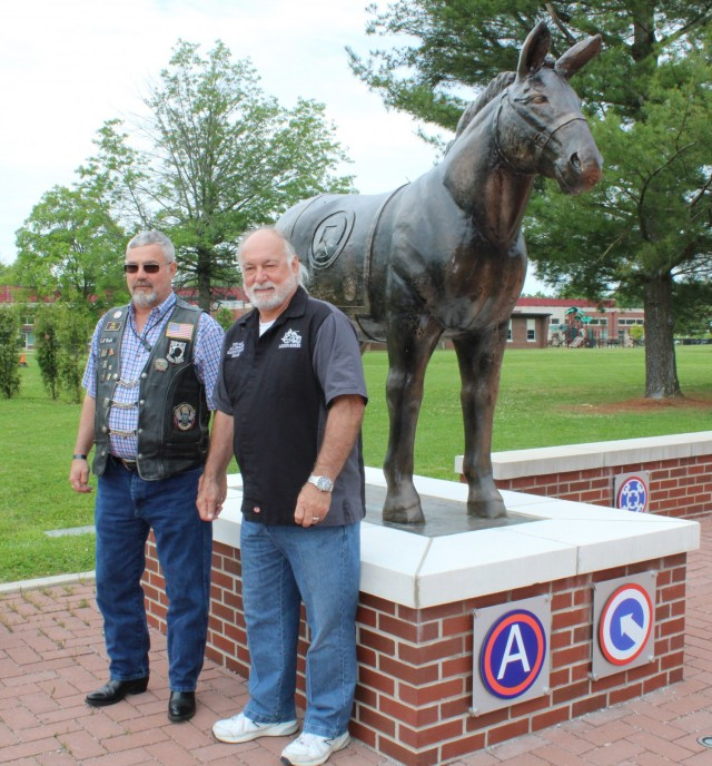 Rich Gano, Legion Riders commander and Bobby Castle, Legion Riders director, American Legion Post 113 in Elizabethtown, Kentucky, stand with the Blackjack statue in front of the 1st Theater Sustainment Command headquarters, May 11, 2021 in Fort Knox, Kentucky. Both men are retired Soldiers from Fort Knox and regularly volunteer with 1st TSC Soldiers, civilians, and families.