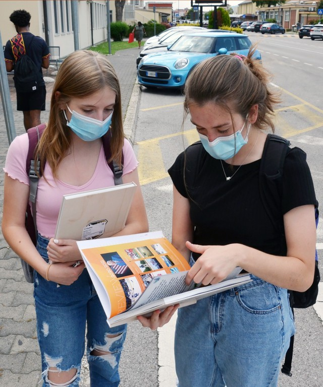 VICENZA, Italy - Vicenza High School students look at their yearly book after leaving school the last day June 10, 2021. While many Department of Defense Education activity Europe schools had to operate in remote learning at some point due to COVID-19, schools in Vicenza remained open for in person instruction the entire year.