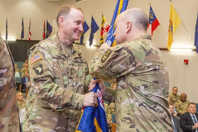 Brig. Gen. David C. Trybula accepts the unit colors to assume command of Natick Soldier Systems Center from Lt. Gen. Thomas H. Todd III, deputy commanding general for Acquisition and Systems management at the U.S. Army Futures Command in Austin, Texas. Trybula most recently commanded White Sands Missile Range and served as the deputy commanding general for developmental testing for the U.S. Army Test and Evaluation Command, located at White Sands, N.M.