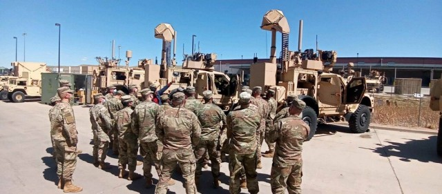 Soldiers huddle during Counter-Small Unmanned Aircraft Systems home-station training at Fort Carson, Colo. The Soldiers were preparing for a deployment to the U.S. Central Command region.