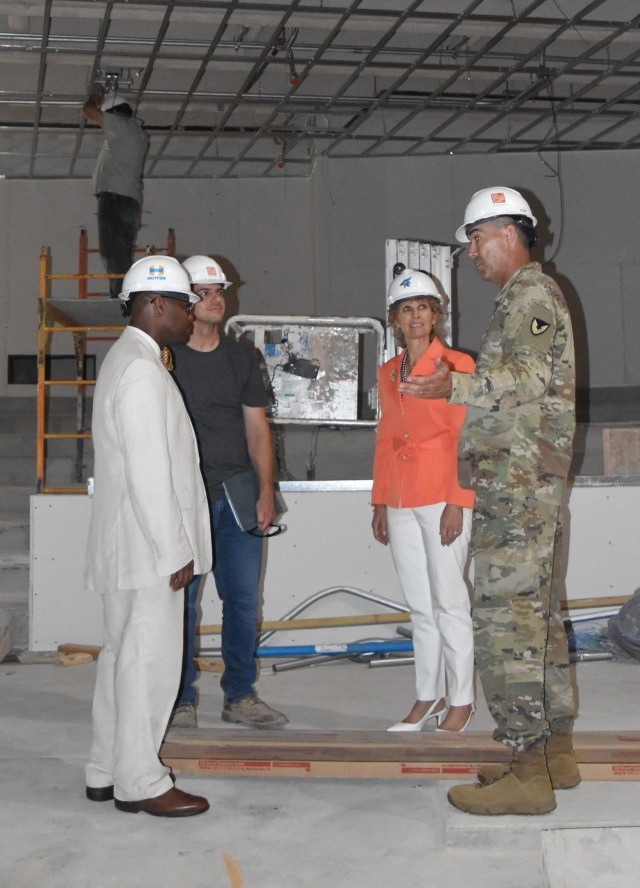 Col. William McKannay, commander, U.S. Army Garrison Fort Riley, right, discusses the partnership between Fort Riley and Geary County Schools Unified School District 475 with Dr. Reginald Eggleston, superintendent; Malcolm Watkins, architect of the new Junction City High; and Maria McConville, spouse of Gen. James C. McConville, chief of staff of the Army in Junction City, Kan. June 11, 2021. More than 50 percent of USD 475 students and many district employees are military connected. (U.S. Army photo by Kaitlin Knauer)