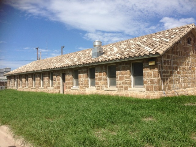 The 63rd Readiness Division Cultural Resources Management team protects a wide variety of historic properties across a seven-state area including buildings such as this Rock Building in Laredo, Texas, which was built in 1942 by the Works Projects Administration.