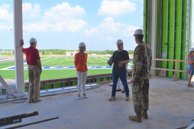 Malcolm Watkins, third from left, architect of the new Junction City High School, discusses the new Junction City High School's design with Mark Edwards, civilian aide to the secretary of the Army emeritus; Maria McConville, spouse of Gen. James McConville, chief of staff of the Army; and Col. William McKannay, commander, U.S. Army Garrison Fort Riley in Junction City, Kan. June 11, 2021. (U.S. Army photo by Kaitlin Knauer)