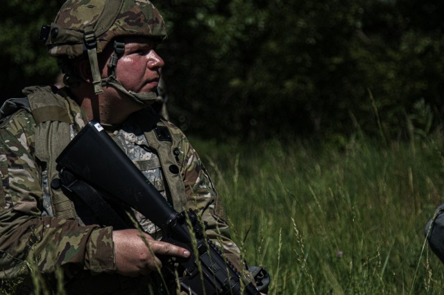 Spc. Christopher Lambert, a human resources specialist for the 463rd Engineer Battalion, stands perimeter security during an automobile rollover simulation, June 9, 2021 at Fort McCoy, Wis.The 463rd is utilizing Warrior Exercise 86-21-02 as an opportunity to refine their Soldiers' ability establish tactical assembly areas, defensive posturing, convoy operations and maintenance, vertical and horizontal construction, and fundamental Soldier skills. (U.S. Army Reserve photo by Sgt. Michael Ito, 364th TPASE)