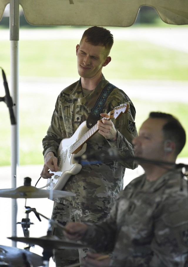 Spc. Patrick Haley, from the 399th Army Band, gets into the music during a performance prior to the Army Birthday Retreat Ceremony June 14 at MSCoE Plaza.