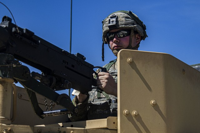 Spc. Kevin Dempsey, a horizontal construction engineer with the 702nd Engineer Company, stands guard at the entrance to Tactical Assembly Area Justice during Warrior Exercise 86-21-02 at Fort McCoy, Wis.   WAREX 86-21-02, beginning the week of June 8, unites more than 75 U.S. Army Reserve units from across the country. The training events build warfighting functionality, and enhance mission command proficiency in support of the Army Reserve's mission to bring leadership, resilience and execution to the force. (U.S. Army Reserve photo by Sgt. Michael Ito, 364th TPASE)