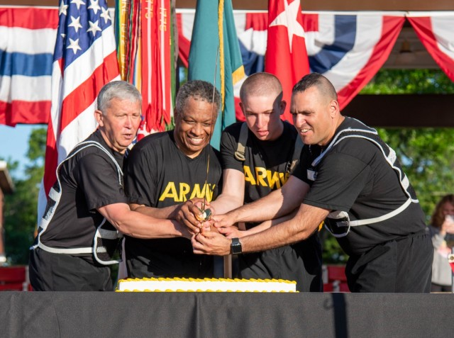 Maj. Gen. James Bonner, Maneuver Support Center of Excellence and Fort Leonard Wood commanding general (left), and MSCoE and Fort Leonard Wood Command Sgt. Maj. Randolph Delapena (right), cut the Army Birthday cake Monday on Gammon Field, with the help of Garrison Chaplain (Lt. Col.) Walter Marshall — the oldest Soldier on post, at 60 years of age — and Pfc. Camerin King, Company B, 31st Engineer Battalion — the youngest Soldier on post, at 17 years of age.