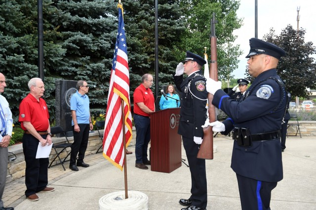 The Buffalo Grove honor guard detail, made up of police officers and fire-fighters from Buffalo Grove, render a salute during a presentation of Colors at the Village of Buffalo Grove annual Flag Day commemoration, June 14, 2021. Army Reserve Lt. Col. Keith A. Cowan, 3rd Battalion, 335 Infantry Regiment, 85th U.S. Army Reserve Support Command, participated in the ceremony as the keynote speaker at Veterans Park. (U.S. Army Reserve photo by Staff Sgt. Erika Whitaker)