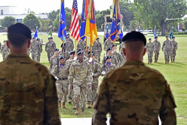 The 1st Aviation Brigade colors march toward the official party during their change of command ceremony at Fort Rucker, Alabama, June 18, 2021. (U.S. Army photo by Lt. Col. Andy Thaggard)