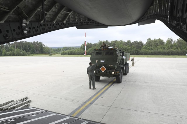 U.S. Army Soldiers assigned to Alpha Battery, 1st Battalion, 77th Field Artillery Regiment, 41st Field Artillery Brigade, drive their High Mobility Artillery Rocket System onto a C-17 Globemaster III aircraft prior to African Lion 2021, at Ramstein Air Base, on June 7, 2021. The 41st FAB is conducting a suppression of enemy air defense in support of an Airborne joint Forcible Entry during African Lion 2021. This dynamic force employment exercise is their fourth exercise in the Fires Shock series, and a sub-exercise of U.S. Army Europe and Africa's Defender 21. African Lion 2021 is U.S. Africa Command's largest, premier, joint, annual exercise hosted by Morocco, Tunisia, and Senegal, 7-18 June. More than 7,000 participants from nine nations and NATO train together with a focus on enhancing readiness for U.S. and partner nation forces. AL21 is a multi-domain, multi-component, and multinational exercise, which employs a full array of mission capabilities with the goal to strengthen interoperability among participants. (U.S. Army photo by Spc. Zack Stahlberg)
